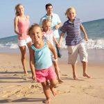 Family having summertime fun at the beach
